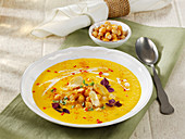 Carrot and parsnip soup with coconut milk and chickpeas