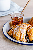 Poppy seed croissant with caramel sauce