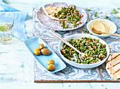 Pita Bread, Tabouli Salad, Hummus and Olives On Tiles