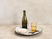 Still Life Bottle, Glasses, Forks And Sea Salt on Plate