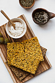 Crispbread with seeds and yoghurt hummus