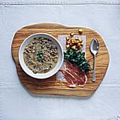 Mushroom soup, crispy potato, spinach and parma ham