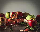 Various apples, some of them peeled