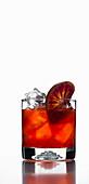 Red cocktail with garnish of a blood orange slice