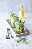 Cucumber salad with red pepper, feta and horseradish oil