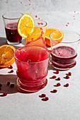 Pomegranate and orange juice splash motion