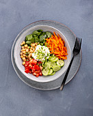 Chickpea bowl with sour cream and spinach