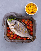 Oven-baked rosemary bream with turmeric rice