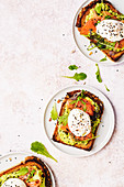 Smoked salmon toasts with avocado cream and poached eggs