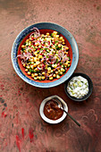 Indian chickpea salad with potatoes, cucumber and pomegranate seeds