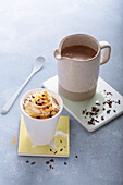 Hot turmeric chocolate topped with cream