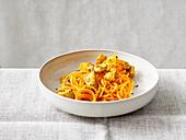 Chicken masala with carrot spaghetti