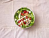 Tomato and rocket salad with turkey strips and mini mozzarella balls