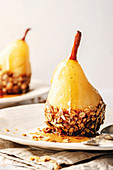 Poached pear with chocolate and granola