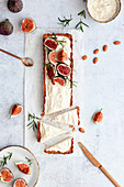 Tart with almond cream, fresh figs and rosemary