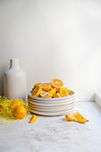 Stack of plates with sliced lemons