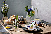 Easter table setting with eggs and hot cross buns