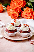 Red velvet cupcakes with whipped cream