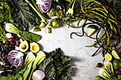 A variety of green and purple vegetable and fruit