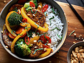 Fried tempeh with vegetables on rice
