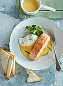 Salmon steak with Holland sauce and poached egg