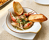 Crab Claws in garlic sauce with toasted bread
