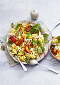 Pasta salad with grilled plums and mozzarella