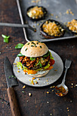 Vegan portobello burger with herb mayonnaise and grilled peppers