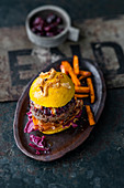 Venison burger with rose hip mayonnaise, cranberries and bacon