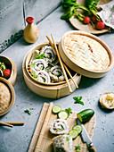 Vegan sushi rolls in a steaming basket