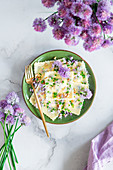 Chives flowers laminated ravioli with cottage cheese and pine nuts