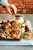 Grilled chicken drumsticks with lemon and maple syrup