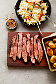 Caveman-style flank steak with bacon chipotle slaw