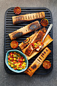Cajun salmon grilled in woodsheets with a mango and lime salsa