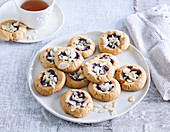 Almond dough cakes with forrest berry jam