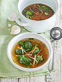 Soup with dumplings in lettuce leaves