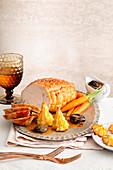 Roast turkey 'Duchess' with cream sauce, prunes and carrots