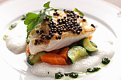 Cod fish with vegetables and basil olive oil