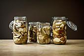 Glass jars of preserved porcini mushrooms