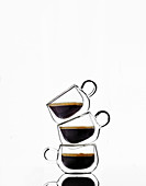 Three glass cups with black coffee