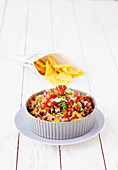 Warm chili cheese dip with minced meat and kidney beans