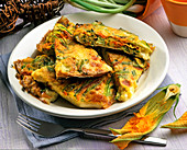 Frittata with caciotta cheese and courgette flowers