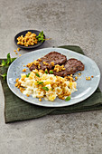 Turnip risotto with nut crumbs with beef minute steaks