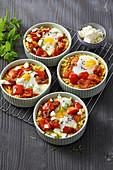 Shakshuka millet casserole with eggs, bell pepper and feta