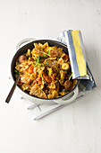 Tuscan dish with pork steak, salsiccia, farfalle and vegetables