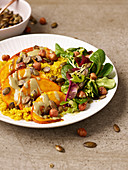 Pumpkin wedges on turmeric quinoa
