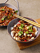 Asian peanut noodles with shiitake, zucchini and date syrup