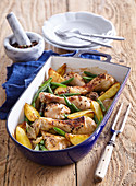 Honey chicken drumsticks with potatoes and green beans