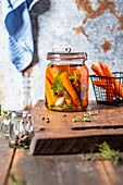 Pickled carrots in glass