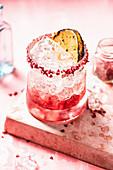 Raspberry Gin Fizz in glass tumbler
